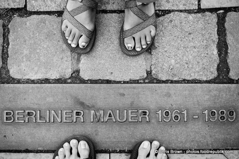 Standing by Berlin Wall